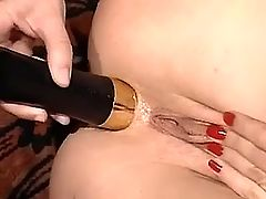 Depraved lesbian gets dildo in ass