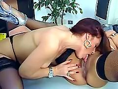 Hot lezzie oral foreplay on table