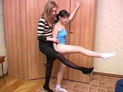 Lesbian coacher trains and tempts a flexible girl
