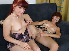 Two old redheads douse each other's firecrotches with pussy juice!